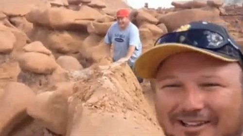 Courtesy image A screen grab from a video showing three men knocking over one of the formations at Goblin Valley State Park.