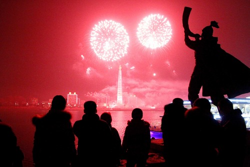Fireworks explode over Juche Tower and the Taedong River in Pyongyang, North Korea to celebrate the New Year on Wednesday, Jan 1, 2014. (AP Photo/Kim Kwang Hyon)