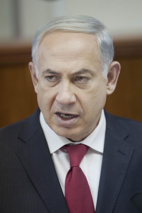 Israeli Prime Minister Benjamin Netanyahu chairs a weekly cabinet meeting at his office in Jerusalem on Sunday, Dec. 29, 2013. (AP Photo/Dan Balilty, pool)