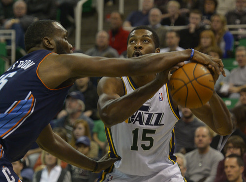 Rick Egan  | The Salt Lake Tribune   Charlotte Bobcats center Al Jefferson (25) knocks the ball out of the hands of Utah Jazz power forward Derrick Favors (15) at EnergySolutions Arena, Monday, December 30, 2013.