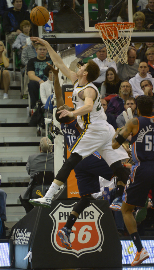 Rick Egan  | The Salt Lake Tribune   Utah Jazz shooting guard Gordon Hayward (20) blocks a shot by Charlotte Bobcats point guard Kemba Walker (15) late in the game, in NBA action at the EnergySolutions Arena, Monday, December 30, 2013.,