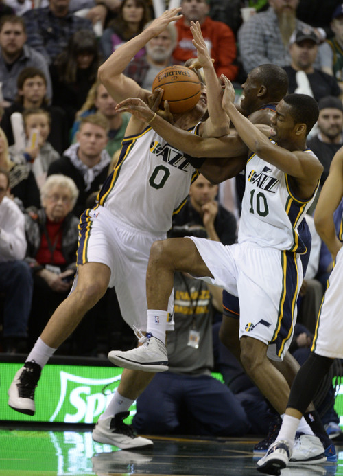Rick Egan  | The Salt Lake Tribune   Utah Jazz center Enes Kanter (0) and Utah Jazz point guard Alec Burks (10) go for the ball along with Charlotte Bobcats center Bismack Biyombo (0) in NBA action, Utah Jazz vs. The Charlotte Hornets, at the EnergySolutions Arena, Monday, December 30, 2013.,