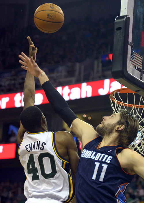 Rick Egan  | The Salt Lake Tribune   Utah Jazz small forward Jeremy Evans (40) goes to the hoop as Charlotte Bobcats power forward Josh McRoberts (11) defends, in NBA action at the EnergySolutions Arena, Monday, December 30, 2013.