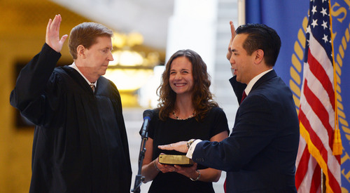Steve Griffin  |  The Salt Lake Tribune  Saysha Reyes holds the Bible as her husband, Sean Reyes, is sworn in as attorney general by Utah Supreme Court Chief Justice Matthew B. Durrant at the Utah State Capitol Rotunda in Salt Lake City Monday, Dec. 30, 2013.