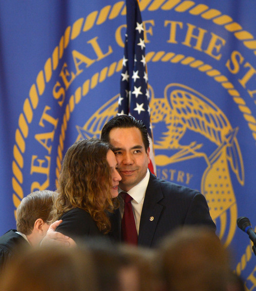 Steve Griffin  |  The Salt Lake Tribune  Utah's new attorney general, Sean Reyes hugs his wife, Saysha Reyes, after being sworn in to office at the Utah State Capitol Rotunda in Salt Lake City Monday, Dec. 30, 2013.