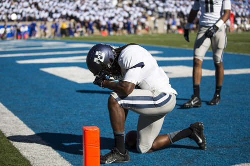 Utah State wide receiver Travis Reynolds celebrates in the end zone after scoring a touchdown during an NCAA college football game against Air Force, Saturday, Sept. 7, 2013, in Air Force Academy, Colo. Utah State won 52-20. (AP Photo/The Gazette, Kent Nishimura)  MAGAZINES OUT
