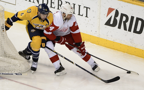 Nashville Predators defenseman Shea Weber (6) tries to knock the puck away from Detroit Red Wings right wing Todd Bertuzzi (44) in the second period of an NHL hockey game on Monday, Dec. 30, 2013, in Nashville, Tenn. (AP Photo/Mark Zaleski)