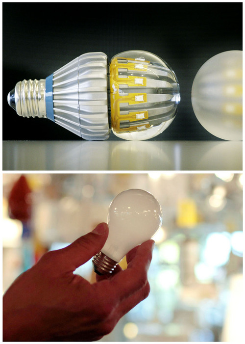 FILE -This combination of Associated Press file photos shows,  top, Switch75 light LED bulbs in clear and frosted, on Tuesday, Nov. 8, 2011 in New York and a 100-watt incandescent light bulb at Royal Lighting in Los Angeles on Jan. 21, 2011.  LEDs use 70 percent to 80 percent less power than incandescent light bulbs. According to the Energy Department, widespread use of LED bulbs could save the output of the equivalent of 44 large power plants by 2027. (AP Photo/File)