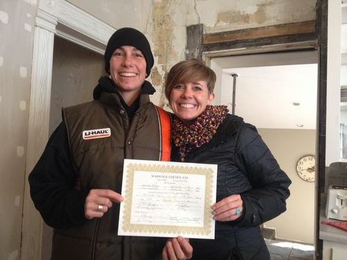 """Marissa Lang     The Salt Lake Tribune Michelle """"Pidge"""" Winburn, left, and Amy Fowler, right, pose with the marriage certificate they were issued on Monday, Dec. 23. The couple celebrated their first Christmas as wife and wife Wednesday in their Sugar House home."""