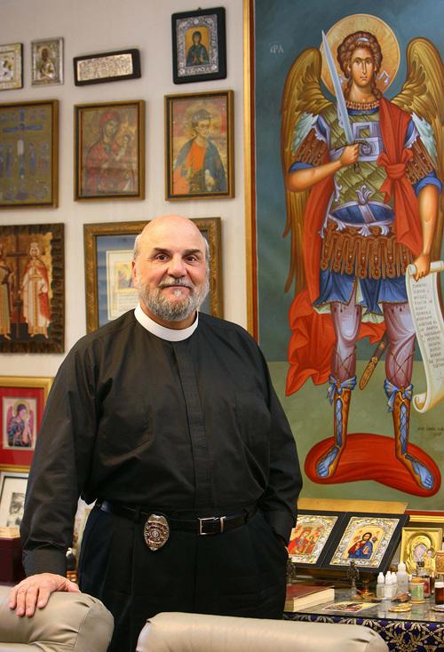 Trent Nelson  |  Tribune file photo Father Michael Kouremetis.