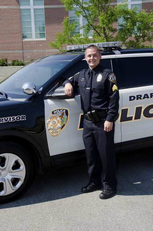 Courtesy Draper City Sgt. Derek Johnson stands in front of his squad car. Johnson, 32, was shot and killed Sept. 1, 2013.