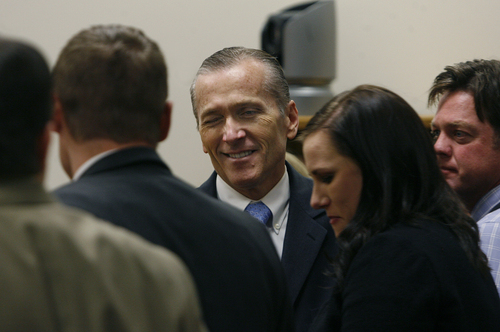 Scott Sommerdorf   |  The Salt Lake Tribune Martin McNeill winks at members of his defense team as he arrived in court for the reading of the verdict. He found guilty of murder and obstruction of justice early Saturday morning, November 9, 2013.