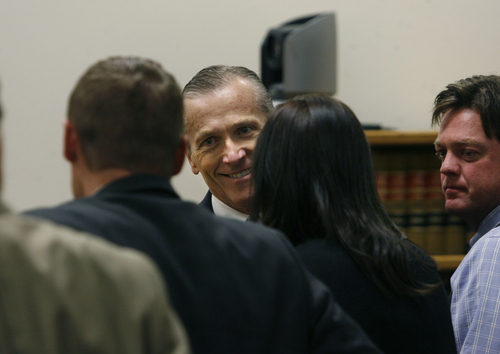 Scott Sommerdorf   |  The Salt Lake Tribune Martin McNeill greets his defense team as he enters the courtroom after the jury reached a verdict. McNeill was found guilty of murder and obstruction of justice early Saturday morning, November 9, 2013.