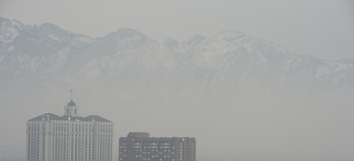Jeremy Harmon     The Salt Lake Tribune  A view of the mountains as seen from downtown Salt Lake City is obscured by an inversion on December 19, 2013.