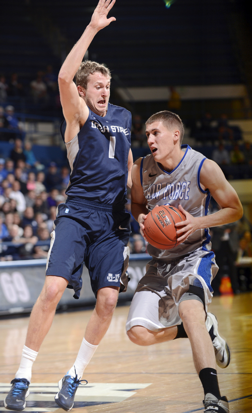 Air Force Academy forward Marek Olesinski, right, drives to the basket past Utah State's Ben Clifford in the second half of an NCAA college basketball game Wednesday, Jan. 1, 2014, in Air Force Academy, Colo. (AP Photo/The Colorado Springs Gazette, Mark Reis)