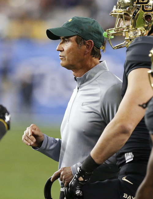 Baylor coach Art Briles talks with his team during the first half of the Fiesta Bowl NCAA college football game against Central Flordia, Wednesday, Jan. 1, 2014, in Glendale, Ariz.  (AP Photo/Ross D. Franklin)