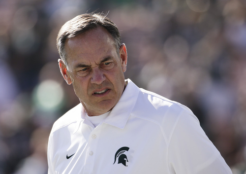 Michigan State coach Mark Dantonio watches his players before the Rose Bowl NCAA college football game against Stanford on Wednesday, Jan. 1, 2014, in Pasadena, Calif. (AP Photo/Jae C. Hong)