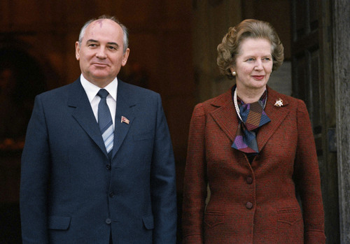 """FILE - In this Dec. 16, 1984 file photo, Mikhail S. Gorbachev poses with Britain's Prime Minister Margaret Thatcher at the prime minister's official country residence in Chequers, north of London. Gorbachev's impromptu appearance at the prime minister's home was revealed in a confidential telegram made public Friday Jan 2, 2014 by the National Archives under the """"30-year rule"""" for declassifying secret documents. (AP Photo/File)"""