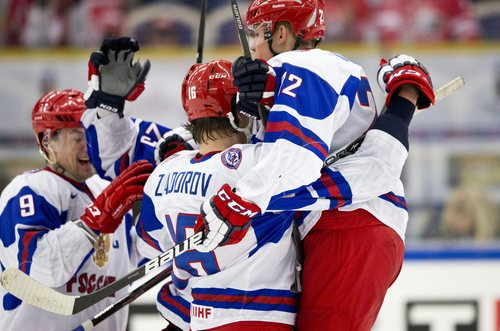 Russia's Anton Slepyshev, left joins happy team mates Nikita Zadorov, center, and Ivan Barbashyov after Slepyshev scored 3-4 in the World Junior Hockey Championships quarter final between USA and Russia in Malmo, Sweden on Thursday, Jan. 2, 2014. (AP Photo / TT News Agency / Andreas Hillergren) **  SWEDEN OUT  **