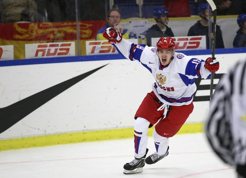 Russia's Pavel Buchnevich jubilates after scoring 3-5 into an empty goal after USA took out their goalie in the final minute of the World Junior Hockey Championships quarter final between USA and Russia in Malmo, Sweden on Thursday, Jan. 2, 2014. (AP Photo / TT News Agency / Andreas Hillergren) **  SWEDEN OUT  **