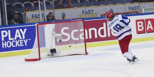 Russia's Pavel Buchnevich scores 3-5 into an empty goal after USA took out their goalie in the final minute of the World Junior Hockey Championships quarter final between USA and Russia in Malmo, Sweden on Thursday, Jan. 2, 2014. (AP Photo / TT News Agency / Andreas Hillergren) **  SWEDEN OUT  **