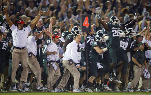 Michigan State players and coaches celebrate a 24-20 win over Stanford in the Rose Bowl NCAA college football game Wednesday, Jan. 1, 2014, in Pasadena, Calif. (AP Photo/Mark J. Terrill)
