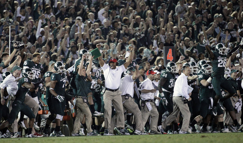 Michigan State players, coaches and fans react to a play during the second half of the Rose Bowl NCAA college football game against Stanford on Wednesday, Jan. 1, 2014, in Pasadena, Calif. Michigan State won 24-20. (AP Photo/Jae C. Hong)