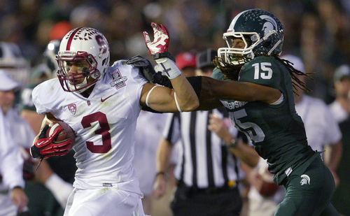 Stanford wide receiver Michael Rector tries to break a tackle by Michigan State cornerback Trae Waynes during the second half of the Rose Bowl NCAA college football game Wednesday, Jan. 1, 2014, in Pasadena, Calif. (AP Photo/Mark J. Terrill)