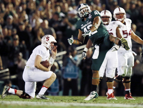 Michigan State defensive end Denzel Drone celebrates after sacking Stanford quarterback Kevin Hogan during the second half of the Rose Bowl NCAA college football game on Wednesday, Jan. 1, 2014, in Pasadena, Calif. (AP Photo/Danny Moloshok)