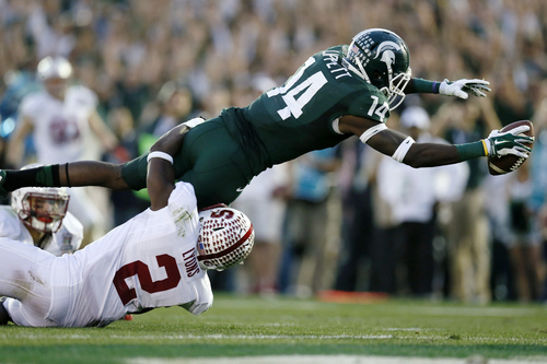Michigan State wide receiver Tony Lippett scores a touchdown against Stanford's Wayne Lyons during the second half of the Rose Bowl NCAA college football game Wednesday, Jan. 1, 2014, in Pasadena, Calif. (AP Photo/Danny Moloshok)