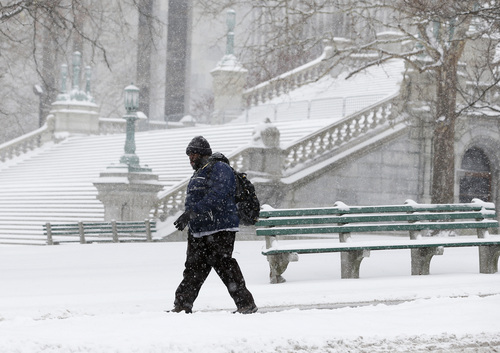 A pedestrian walks through the snow outside the state Capitol on Thursday, Jan. 2, 2014, in Albany, N.Y. Up to 5 inches of snow have fallen in eastern New York early Thursday, but the National Weather Service said some areas from Buffalo to Albany could get up to 12 inches by the time the storm subsides on Friday. (AP Photo/Mike Groll)