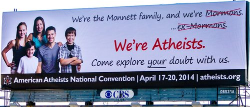 "Courtesy photo  |  American Atheists A billboard on Interstate 15 near the 3300 South exit shows a South Jordan family who announce ""We're Atheists"" in support of the American Atheists' national convention this April in Salt Lake City."