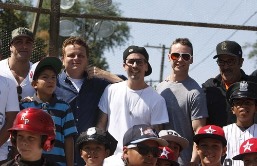 "Leah Hogsten  |  The Salt Lake Tribune l-r ""The Sandlot"" actors Marty York (Yeah-Yeah), Patrick Renna, (Hamilton ""Ham"" Porter), Chauncey Leopardi (Squints),  Victor DiMattia (Timmy Timmons) and Daniel Zacapa (Police Chief) pose for pictures. The Salt Lake Bees baseball players conducted a morning clinic with Glendale and Rose Park area kids on original sandlot field, Saturday, July 20, 2013 for the 20th anniversary of ""The Sandlot,"" the classic baseball movie filmed primarily in Utah."
