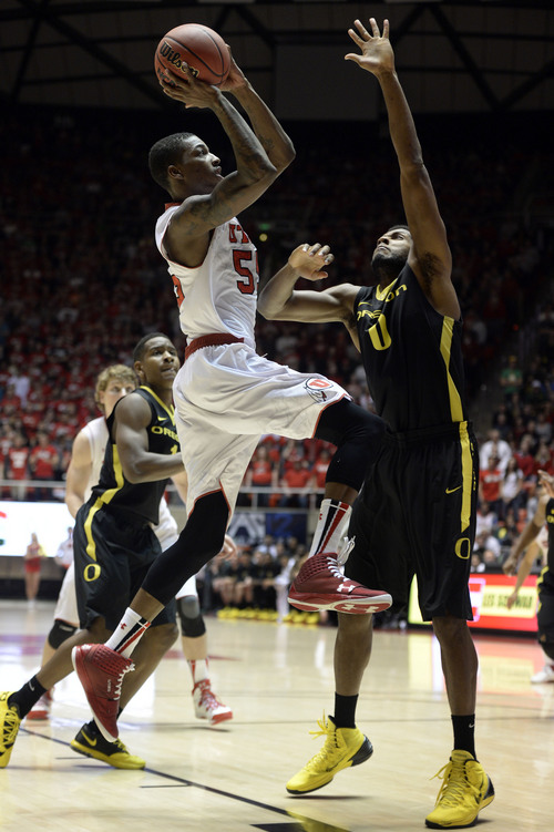 Francisco Kjolseth  |  The Salt Lake Tribune Utah Utes guard Delon Wright (55) sneaks one in to give the Utes a little bit of hope before being shut down by Oregon 70 to 68 in game action at the Hunstman Center on the University of Utah campus on Thursday, Jan. 2, 2014.