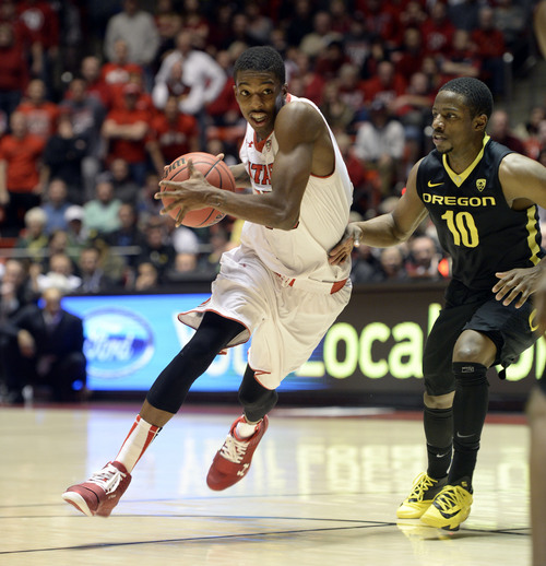 Francisco Kjolseth  |  The Salt Lake Tribune Utah Utes guard Delon Wright (55) moves the ball down court against Oregon Ducks guard Johnathan Loyd (10) in game action at the Hunstman Center on the University of Utah campus on Thursday, Jan. 2, 2014.
