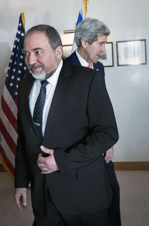 Israeli Foreign Minister Avigdor Lieberman, walks in front of U.S. Secretary of State John Kerry, ahead of their meeting at the David Citadel hotel  in Jerusalem, Friday, Jan. 3, 2013. (AP Photo/Brendan Smialowski, Pool)