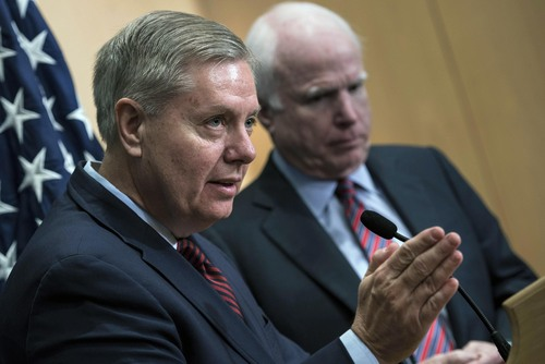 """U.S. Sens. Lindsey Graham, left, speaks as John McCain listens during a press conference at the David Citadel hotel in Jerusalem, Friday, Jan. 3, 2014. Republican Sen. McCain said Israeli Prime Minister Benjamin Netanyahu has """"serious, serious concerns"""" about parts of the proposal Secretary of State John Kerry is using to broker peace with the Palestinians. (AP Photo/Brendan Smialowski, Pool)"""