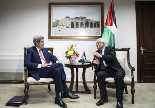 """U.S. Secretary of State John Kerry, left, and Palestinian President Mahmoud Abbas talk before a meeting at the presidential compound in the West Bank city of Ramallah, Friday, Jan. 3, 2014. Kerry took the tenth trip to the region to negotiate a peace deal he claims is """"not mission impossible."""" (AP Photo/Brendan Smialowski, Pool)"""