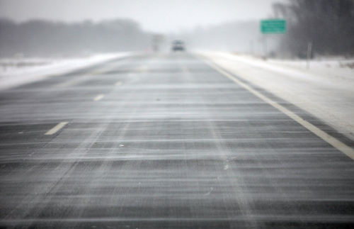 Snow blows across south bound US Route 131 in Kalamazoo, Mich. on Thursday, Jan. 2, 2014. A multi-day storm dropped up to a foot of snow on parts of Michigan, causing crashes and spinouts on roadways. Snowfall began Tuesday and continued Thursday morning. (AP Photo/Kalamazoo Gazette-MLive Media Group, Mark Bugnaski) ALL LOCAL TV OUT; LOCAL TV INTERNET OUT