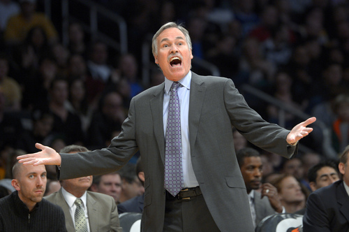 Los Angeles Lakers coach Mike D'Antoni yells at referees during the first half of an NBA basketball game against the Utah Jazz, Friday, Jan. 3, 2014, in Los Angeles. (AP Photo/Mark J. Terrill)