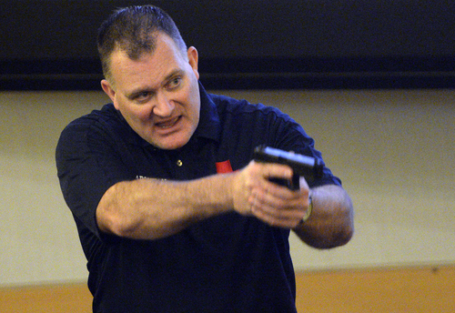 Rick Egan  | The Salt Lake Tribune   Using a plastic gun replica, Clark Aposhian gives instructions during a free concealed firearms permit class to Utah educators at the Salt Lake City Library, Friday, January 3, 2014.