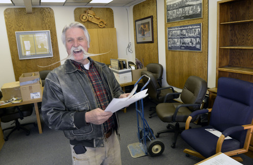 Al Hartmann  |  The Salt Lake Tribune After four terms (16 years) Dan Snarr with his signature handlebar mustache is leaving his post as mayor of Murray.  He laughs reading a piece of cowboy poetry he's found cleaning out the office at Murray City Hall December 31, 2013.