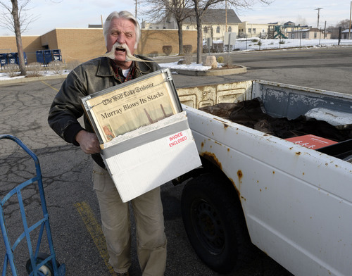 Al Hartmann  |  The Salt Lake Tribune After four terms (16 years) Dan Snarr with his signature handlebar mustache is leaving his post as mayor of Murray.  He loads up keepsakes from his office into his ancient, rusted out Chevy S-10 truck at Murray City Hall December 31, 2013.
