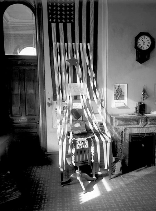 (Courtesy Utah State Historical Society)  Image shows a desk at a City and County Building office in 1918 that has been decorated in celebration of someone's recent marriage.