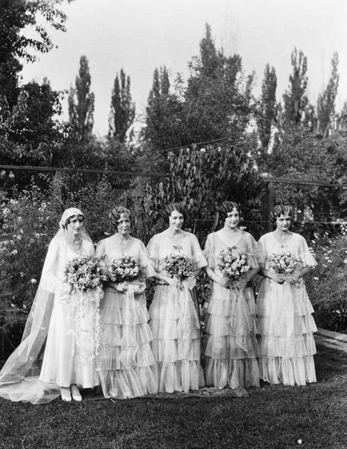 (Courtesy Utah State Historical Society)  Mrs. Chase (A. F. Smith) and her Bridesmaids, 1930.