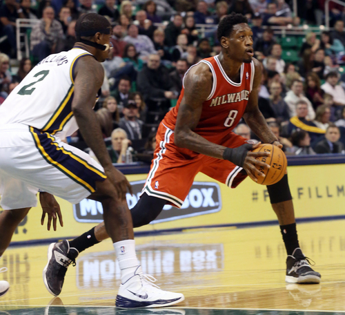 Milwaukee Bucks' Larry Sanders (8) looks to pass as Utah Jazz's Marvin Williams (2) defends during the second half of an NBA basketball game Thursday, Jan. 2, 2014, in Salt Lake City.  The Jazz won 96-87. (AP Photo/Kim Raff)