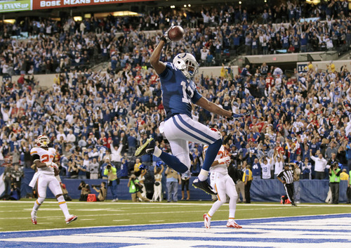 Indianapolis Colts wide receiver T.Y. Hilton (13) makes a touchdown to move ahead of Kansas City Chiefs 45-44 during the second half of an NFL wild-card playoff football game Saturday, Jan. 4, 2014, in Indianapolis. (AP Photo/AJ Mast)