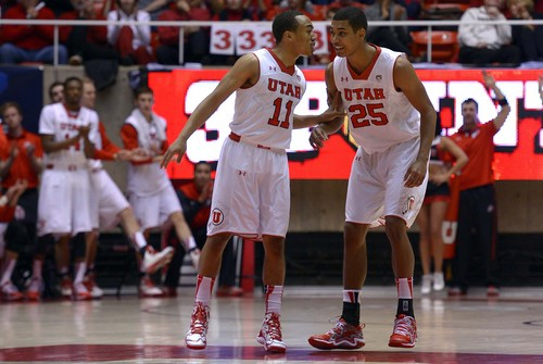 Leah Hogsten  |  The Salt Lake Tribune Utah Utes guard Brandon Taylor (11) and Utah Utes guard Kenneth Ogbe (25) share a laugh after Taylor hit a three-point shot. The University of Utah defeated Oregon State 80-69 during their game Saturday, January 4, 2014 at the Huntsman Center.