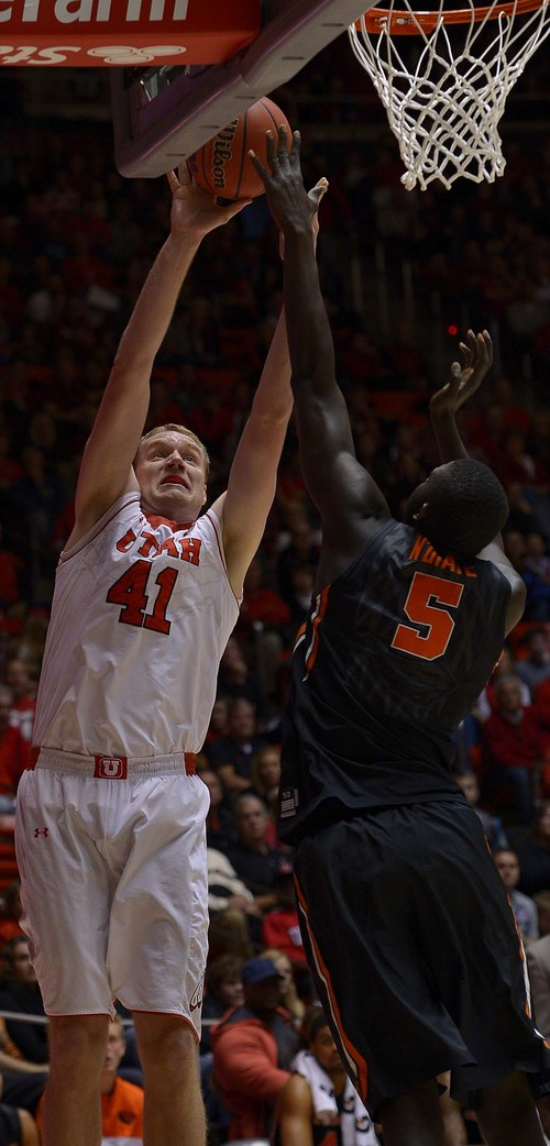 Leah Hogsten  |  The Salt Lake Tribune Utah Utes center Jeremy Olsen (41) is fouled by Oregon State Beavers center Cheikh N'diaye (5) while driving to the net. The University of Utah defeated Oregon State 80-69 during their game Saturday, January 4, 2014 at the Huntsman Center.