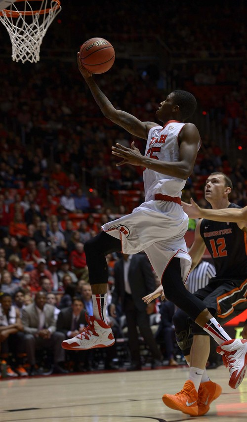 Leah Hogsten  |  The Salt Lake Tribune Utah Utes guard Delon Wright (55) for two. The University of Utah defeated Oregon State 80-69 during their game Saturday, January 4, 2014 at the Huntsman Center.